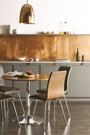 copper backsplash tiles kitchen surfaces pinterest trend lustrous gold statements in tile lighting kitchens flooring