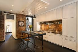 cocina con suelo de caucho abotonado tipo goma pirelli inspiring minimalist loft kitchen design with white wooden cabinetry and simply dining table with stools charming the kitchen in the loft a budget option