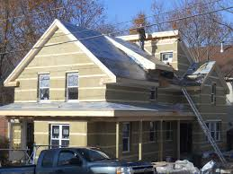 Insulation Blanket Under Metal Roof by Wrapping An Older House With Rock Wool Insulation
