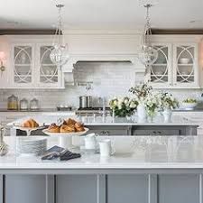 Gray Kitchen Island A Large Contemporary Kitchen Features A Calcutta Marble Waterfall