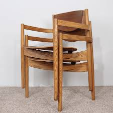 pair of jens risom stacking chairs midmod decor