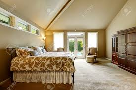 luxury bedroom interior in soft beige color with beautiful bed