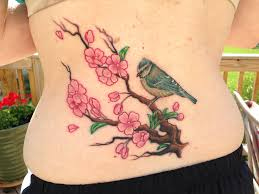 cover up of a small lower back blue in cherry