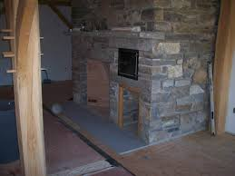 fireplace with wood storage built in fire