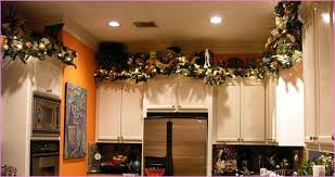 Above Kitchen Cabinet Decorations What To Put Above Kitchen Cabinets White Counter Storage Design