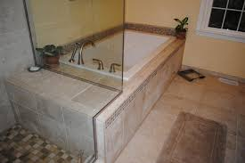 white drop in tub tile floor tub surround and shower drop in