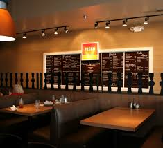 Cozy Ambient Lighting With Wooden Table And Exclusive Leather - Fast food interior design ideas