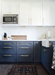 navy blue kitchen cabinets with brass hardware navy brass modern kitchen remodel the vintage rug shop