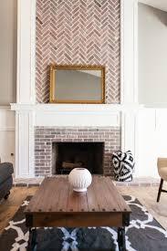 custom fireplace with herringbone brick work by rafterhouse