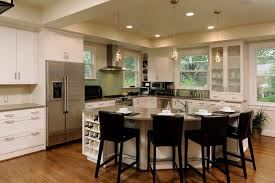 kitchen cabinets microwave home design curved countertop with dark bar stools and white