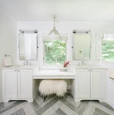 sconce above mirror powder room traditional with beige tile wall