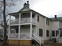 jim yowell design services one of the pleasantries of the traditional virginia farmhouse is the porch this addition celebrates that tradition with a two story porch on the end and a