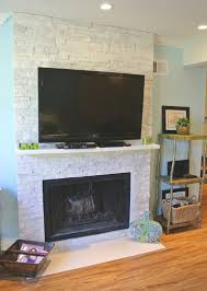 gorgeous white limestone fireplace lose the awful television and a beam mantle