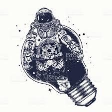 astronaut in a light bulb tattoo art symbol of creative thinking
