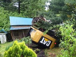 Tractor Barn Logging Equipment Rolls Off Tractor Trailer Smashes Through Eagle