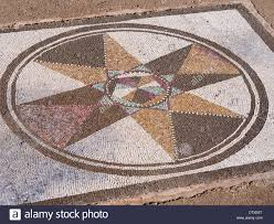 mosaic floor in ruins of empuries complex a colourful patterns in