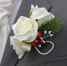 wedding flowers buttonholes christmas themed wedding buttonhole with berries spruce