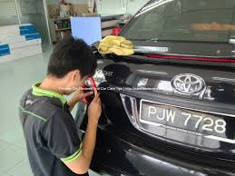 nissan almera tail light headlamp and tail lamp tint installation at breyton window tint shop