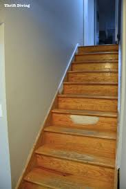 How To Install Laminate Floor On Stairs Before U0026 After Diy Painted Stairs Makeover Thrift Diving Blog