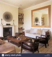 Mirror Sofa Table by Large Mirror Above Sofa In Townhouse Living Room With Wooden