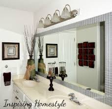 frame your bathroom mirror with metallic tile frame for the home