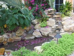 Florida Backyard Landscaping Ideas by Waterfall And Pond In Front Yard Garden Florida Tropical Garden