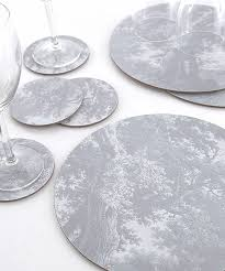 table mats and coasters two silver tablemats and coasters