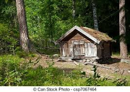 small wooden house of forester on forest margin in