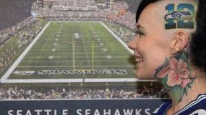 brand new tattoos seahawks logo on her head