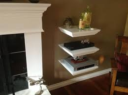 triple white wooden shelves with square shelves placed on the