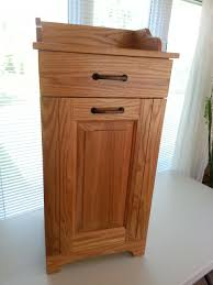 Kitchen Island With Garbage Bin by Tilt Out Trash Can Cabinet