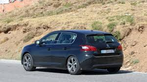 peugeot for sale usa peugeot 308 spied while hiding a facelift