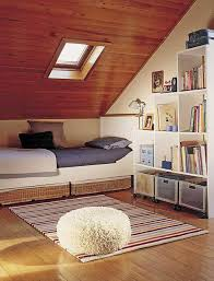 living bedroom attic bedroom idea with sloped wooden ceiling