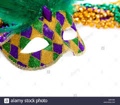 green mardi gras mask a purple gold and green mardi gras mask and on white stock