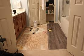 peel and stick vinyl plank flooring diy sprinkled with sawdust