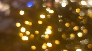 blurred lights balls of garlands colorful lamps square of city is