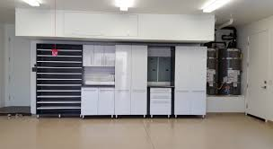 custom garage cabinets and garage organization systems garage organization system with epoxy coated floors