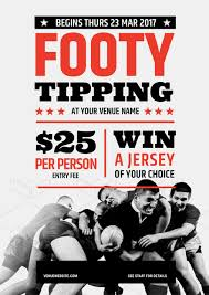 footy tipping with afl u0026 nrl footballs on grass background