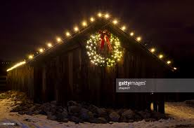 lighted christmas wreath lighted christmas wreath on barn stock photo getty images