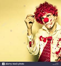 scary grunge clown in dirty business suit and tie drawing on the