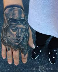 guardian angel statue tattoo
