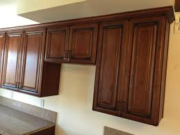 merlot cherry kitchen cabinets with quartz mitered edge