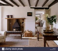 cottage livingroom old oak table and wooden floor in white cottage living room with