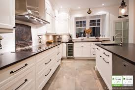 shaker style kitchen with lacquered cabinets and mat granit