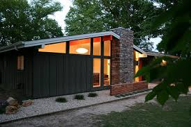 front of house at dusk 3 mid century landscaping mid century