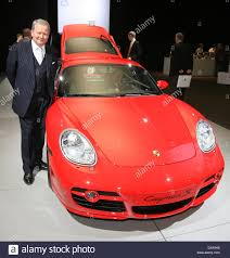 wolfgang porsche wolfgang porsche is pictured beside a porsche cayman s prior to