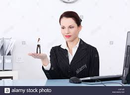 businesswoman holding a miniature of worker on her hand that she