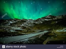 where are the northern lights located aurora borealis or northern lights over geothermal area stock photo