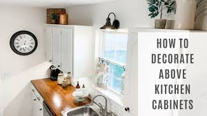 what to put on top of kitchen cabinets for decoration how to decorate above your kitchen cabinets