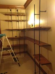 large pipe shelving project steps w distressed wood album on